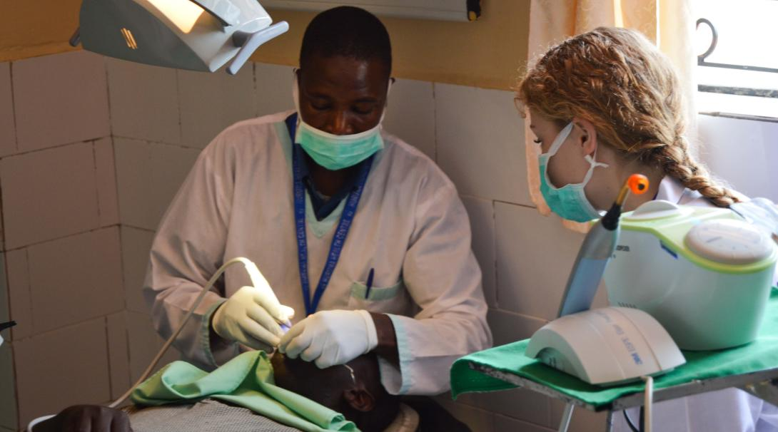 A teenage volunteer doing a medical internship with Projects Abroad in Kenya shadows a medical professional.
